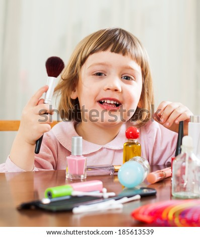 three year old child  painted cosmetics