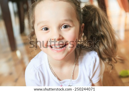 Three year old cute girl playing with connecting blocks
