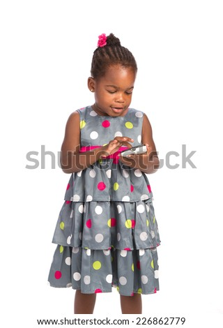 Three Years Old Adorable African American Girl Tap Text on Cellphone Isolated White Background - stock photo