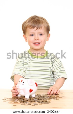 three years old boy and piggy bank isolated on white