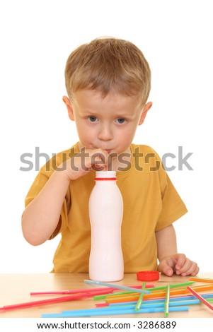 three years old boy drinking milk isolated on white - stock photo