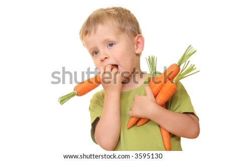 three years old boy eating fresh carrot isolated on white - stock photo