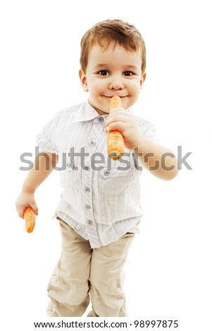 Three years old boy eating fresh carrot. Isolated on white background
