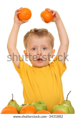 three years old boy playing with fruits isolated on white - stock photo