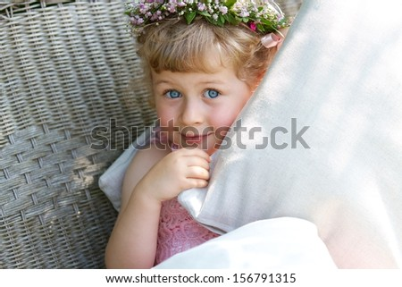 Three years old bridesmaid with wreath on the head - stock photo