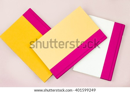 Three Yellow and Stacked Books - stock photo