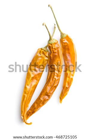 Three yellow dried chili peppers.