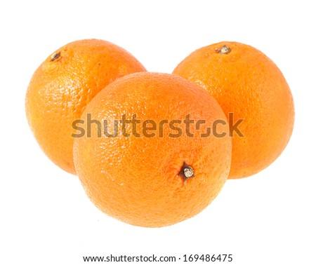 Three yellow tangerine, insulated on white background - stock photo