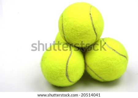 Three yellow tennis balls on white background - stock photo