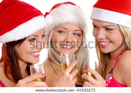 Three young and sexy girls celebrate Christmas and New Year - stock photo