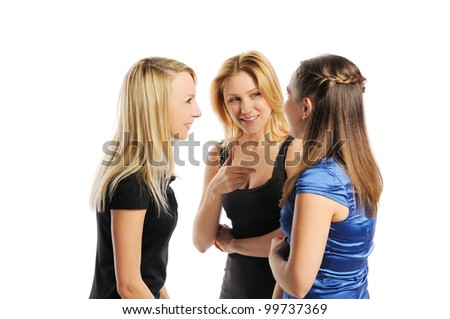 Three young attractive women discussing. Isolated on white. - stock photo