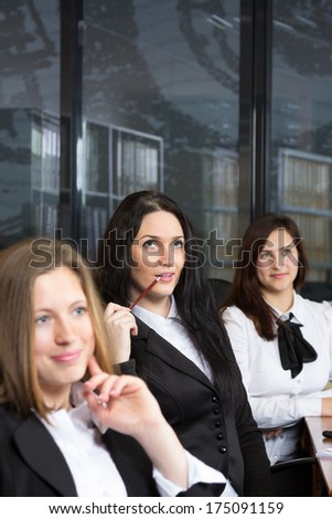 Three young beautiful office workers