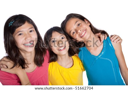 Three young best girl friends in a studio. - stock photo