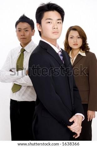 Three young business executives on a white background