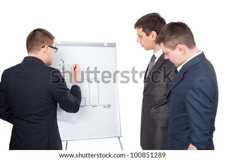 Three young  business men and a flipchart isolated on white background - stock photo
