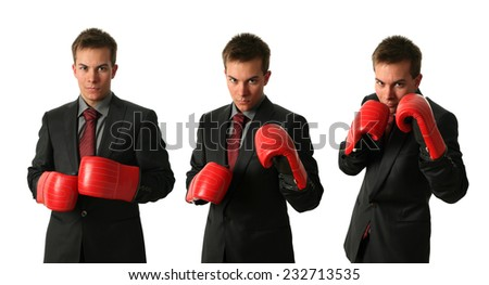 Three young businessmen wearing boxing gloves isolated on white - stock photo