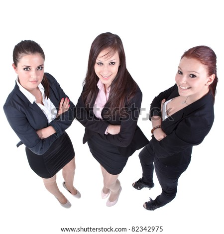 Three young businesswomen isolated over white. Modern, fresh and candid. - stock photo