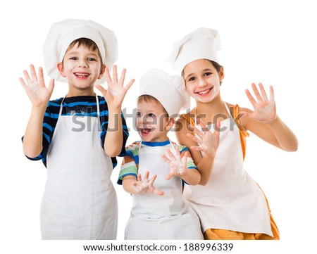 Three young chefs with raised hands in flour, isolated on white - stock photo