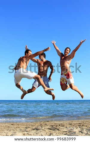 Three Young friends jumping On the Beach - stock photo