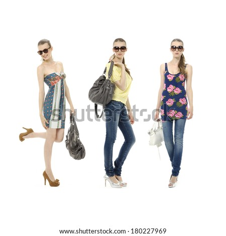 three young girl in jeans in sunglasses and with bag