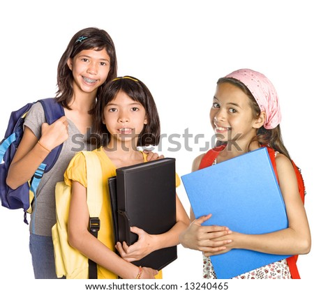 Three young girl students with books, folders and rucksack for school. - stock photo