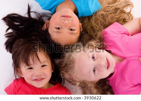 Three young girls growing up. Childhood, learning, exploration family - stock photo