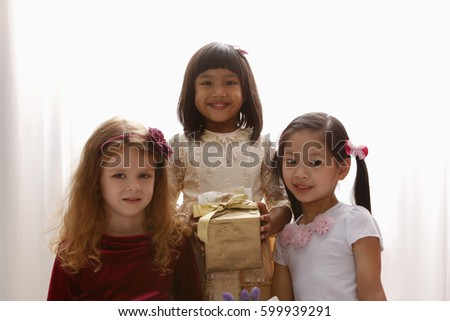 three young girls smiling together