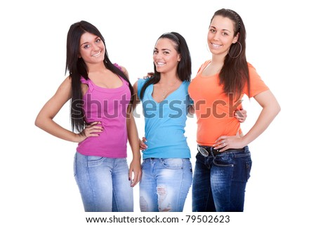 three young girls teenagers, posing on white background - stock photo