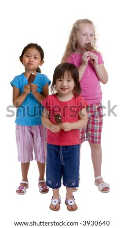 Three young girls with a summertime treat. Ice cream cones. - stock photo