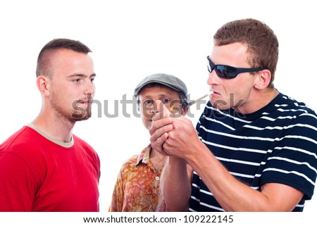 Three young guys going to smoke hashish joint, isolated on white background. - stock photo