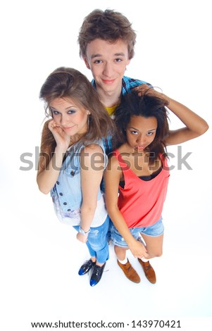 Three young happy teenagers grimacing. Isolated on white background.