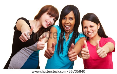 Three young happy woman showing their thumbs up
