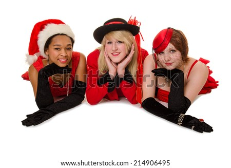 Three young ladies pose in their Christmas Party Dresses and Hats - stock photo