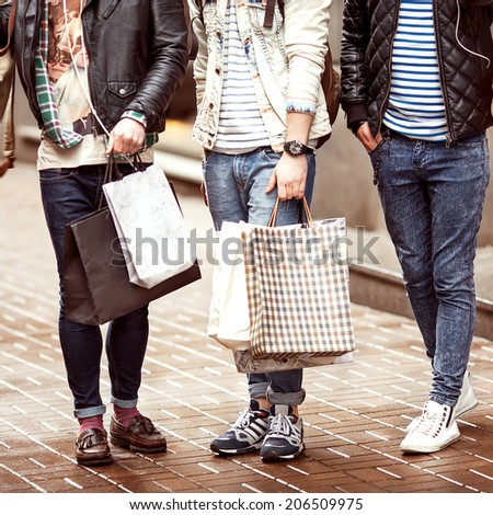 Three Young male fashion metraseksualy shop shopping walk - stock photo