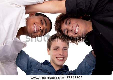 three young man of different colors,looking to camera and smiling, view from below