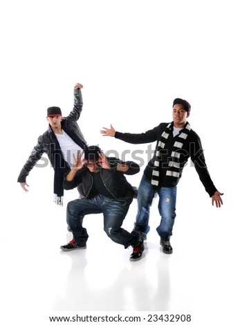 Three young men dancing hip hop moves - stock photo