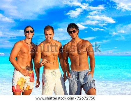 Three Young Men Relaxing On the Beach