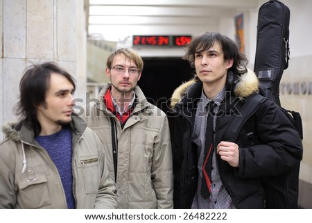 Three young musicians at metro station - stock photo