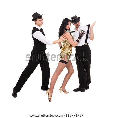 three  young old-fashioned dancers posing on a white background - stock photo