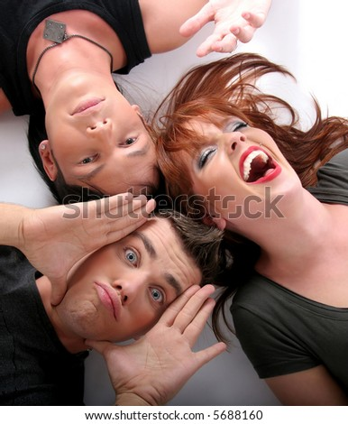 three young people in the white floor - stock photo