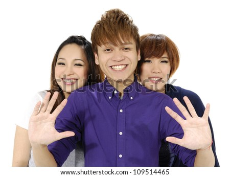 Three young people smiling-close up - stock photo