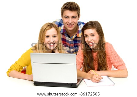 Three young people with laptop - stock photo
