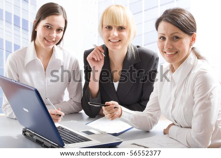 Three young professionals looking at camera - stock photo