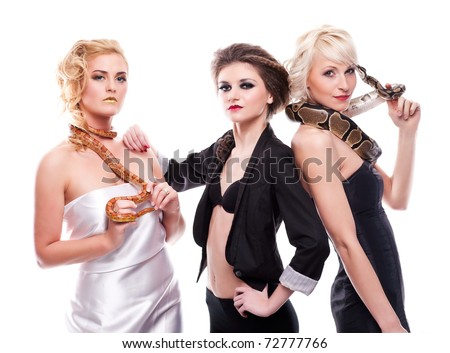 Three young, sensual, sexy women with dangerous creatures- royal python, corn snake and hairy, black spider standing together on white background, isolated, a lot of copyspace available - stock photo