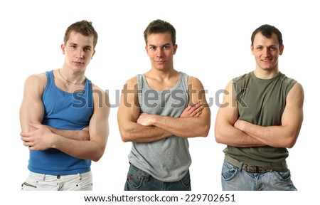 Three young sexy men wearing sleeveless shirts isolated on white - stock photo