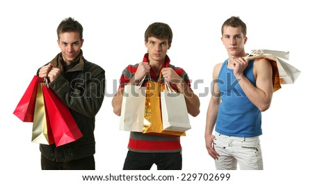 Three young sexy men with copy space shopping bags isolated on white - stock photo