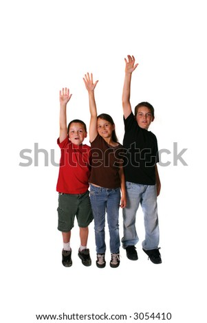 Three Young Students Raising Their Hands Waiting to Be Called Upon
