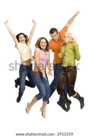 Three young woman and a man are jumping. Isolated on white in studio. - stock photo