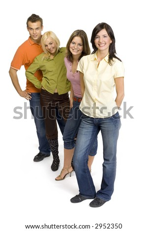 Three young woman and a man are standing on the white background in the studio and smiling. Focus on the first person's face. Whole the bodies are visable. - stock photo