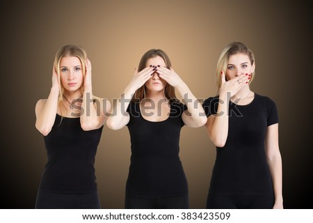 Three young woman in black clothes isolated at brown background showing blind, deaf and dumb: wise monkey scene - hear no evil, see no evil, speak no evil - stock photo